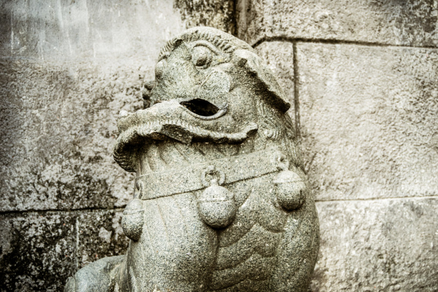 Broken stone lion in Intramuros