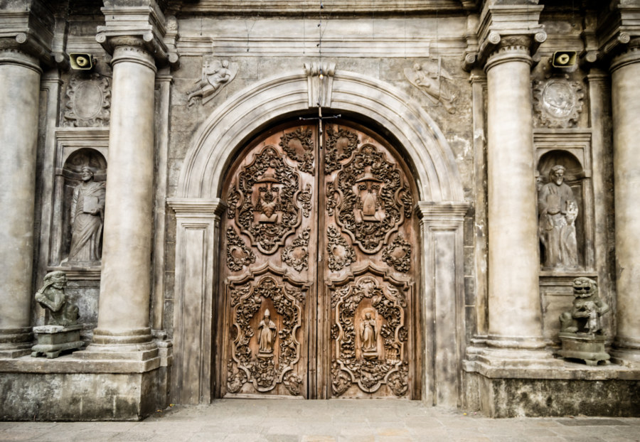 An ornate entrance to San Agustin in Intramuros