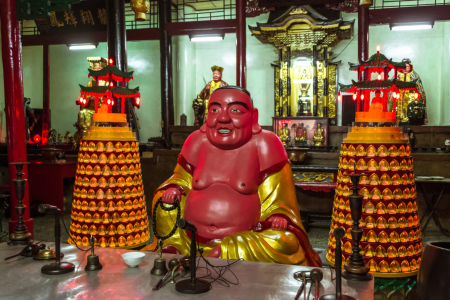 A chubby red Buddha in a temple in Changhua City