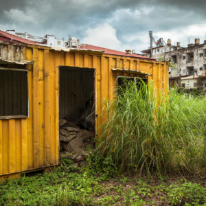 A yellow shed in an empty lot in Hualien