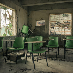 Green chairs at the abandoned clinic