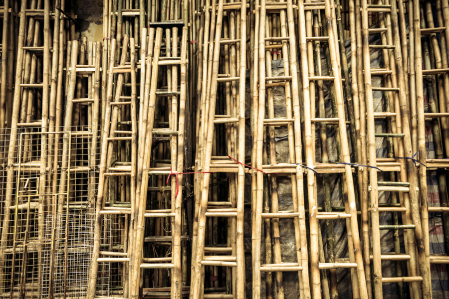 Bamboo ladders against a wall in the Old Quarter