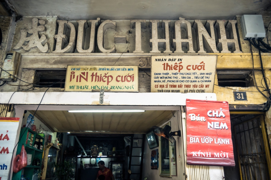 Classic lettering over a shop in the Hanoi Old Quarter